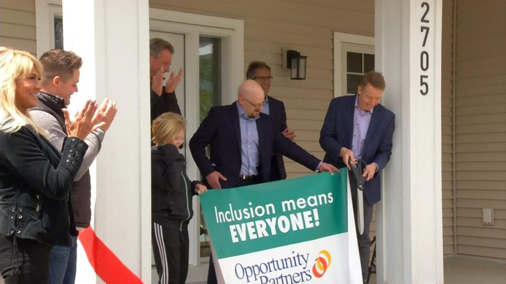 Doug's Place Opportunity Partners ribbon cutting